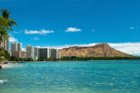 Waikiki beach with azure water in Hawaii with Diamond Head in background