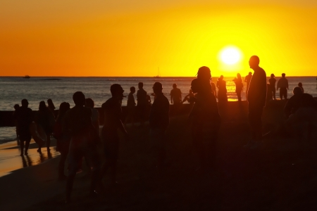 waikiki beach: Young people having party on the beach during the sunset Stock Photo