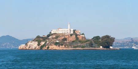 Alcatraz jail island in San Francisco bay with a beautiful blue sky in background panorama photo