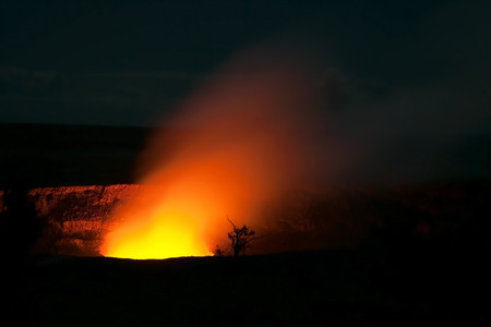 Smoking Crater of Halemaumau Kilauea Volcano in Hawaii Volcanoes National Park on Big Island at night photo