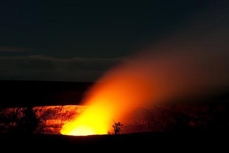 Smoking Crater of Halemaumau Kilauea Volcano in Hawaii Volcanoes National Park on Big Island at night photo
