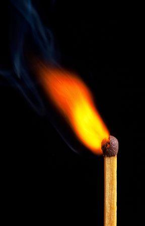 glows: Burning match - fox tail flame Stock Photo