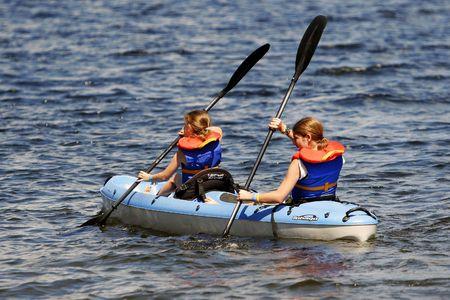 watersport: Two girls in kayak Stock Photo