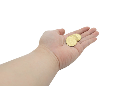 Hand holding coin on palm side in money management concept on isolated white background with clipping path