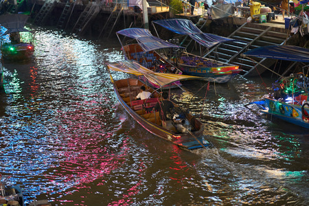 Thailand,Samut songkhram,30 Dec 2017,hired boat for travel night sihgt seeing along river on floating market named Amphawa.