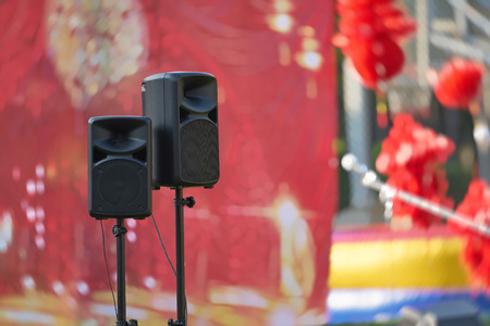 speakers and stand in front of stage ,concert show outdoors daytime
