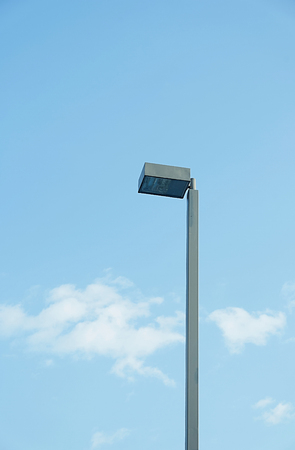 lamp on pole on blue sky background bottom view