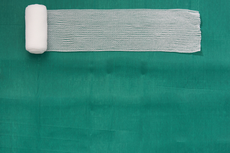 Roll gauze or thin bandage on medical tray on isolated white background for dressing or clean wound concept Stockfoto
