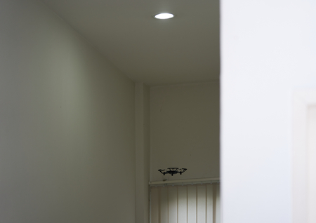 Drone fly in room near ceiling