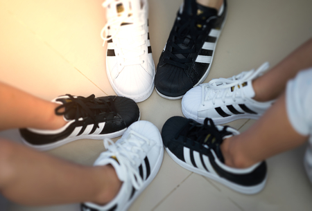 Bangkok,Thailand,July 18,2018-Pairs of black and white color sneaker adidas shoes in vary sizes.jpg