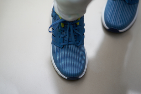 blue sport shoes on walking step top view