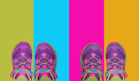 two pairs of kid shoes  on four pastel colors background 写真素材