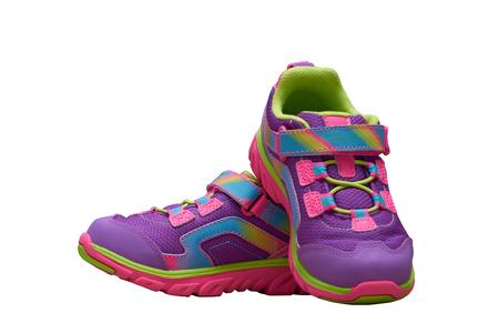 Zapatos de niños coloridos sobre fondo blanco aislado Foto de archivo