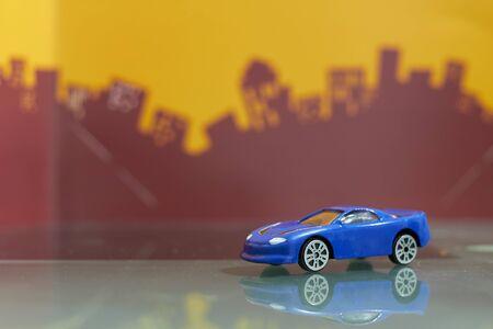 blue Sedan car toy selective focus on blur city background