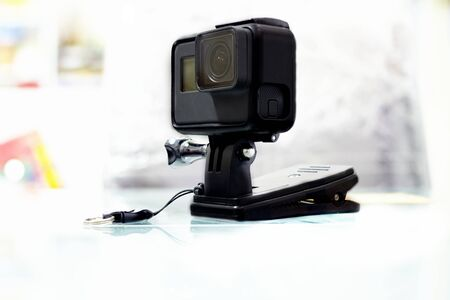 Action camera in case for clamping strand on floor Фото со стока