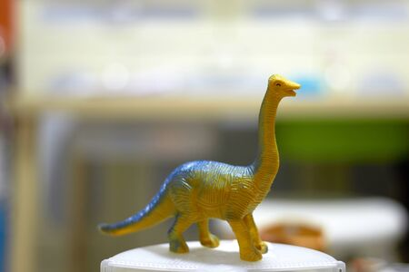 long neck tall Dinosaur toy figure on blur background
