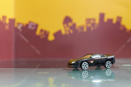 Black Sport racer car toy selective focus on blur city background