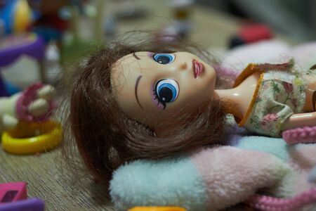 Doll in lie down position with eye contact in girl toy concept
