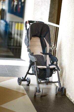 Empty Ordinary stroller on hall walkway