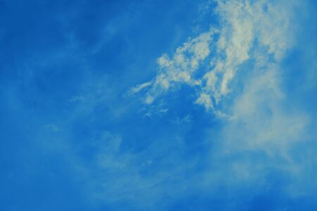 Blue sky background with small clouds Imagens
