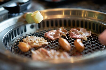 Grilling sliced pork and Marshmallows on korean grill style