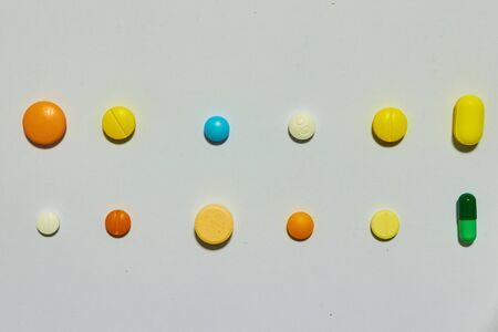 Multiple kinds of medicine drug include Tablet,pill,coated tabs ,capsules round and ovals on white background