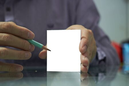 Hands hold pencil and show  plain stick it paper in work uniform