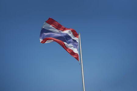 Nation Thai flag on air wind on blue sky background