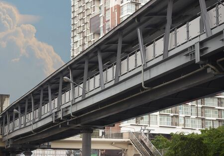 Overpass or sky walk with blur condo and sky background