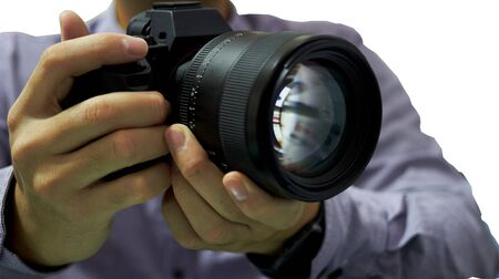Hands hold camera and lens for take photo on isolated white background