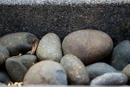 Round and oval shape Stones with concrete wall