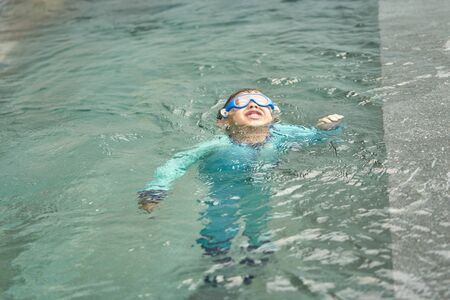 Boy play water and floats alone in safty concept