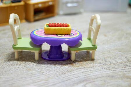 dozen of eggs on Toy table with chairs