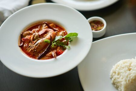 Tom yam kung with rice and fish sauce dip in Thai traditional famous dish Imagens