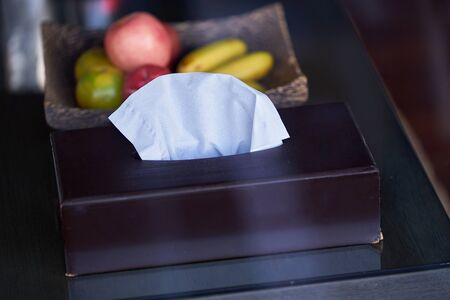 tissue cleaning paper in box on fruits background