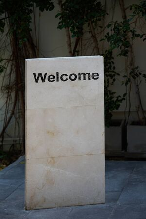 Rock manument stand for welcome message reception label or stone sign