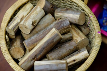 cutted fire woods in basket