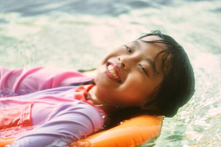 Girl portratit in swimming suit with happy face expression in summer vacation concept