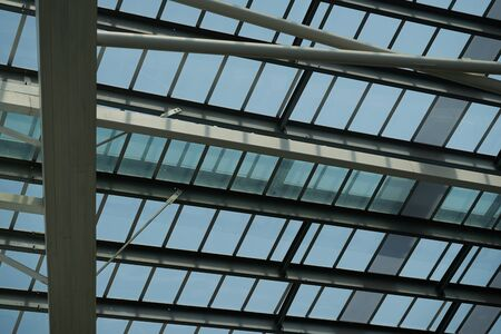 Roof top inside metal structure and mirror bottom see sky Imagens
