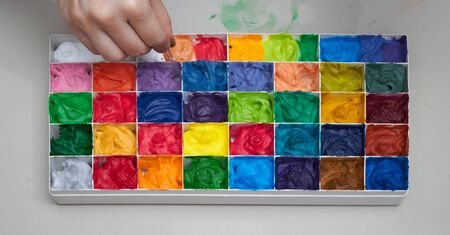 Colorful palates for art work with hand mixing