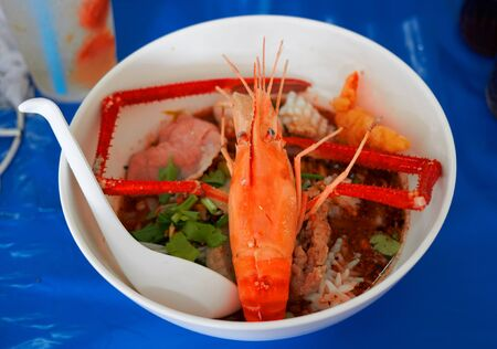 Noodles prawn shrimp soup or Tom yum kung in bowl on table serve