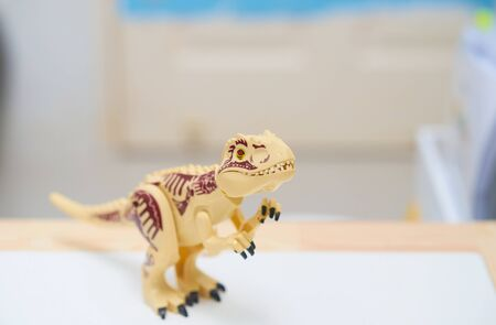 T rex or Tyranosaurus dinosaur toy in hunting posture Stock fotó