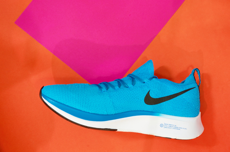 Bangkok ,Thailand ,July 10,2019-nike running or sport shoes on colorful floor Editorial
