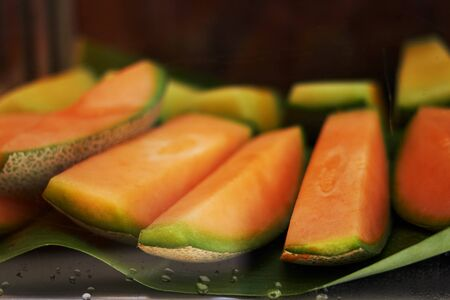 orange sliced melon or Thai melon in natural banana leaf serve,closed up 版權商用圖片