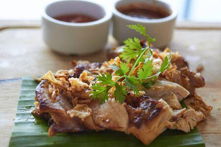 Chicken steak with dip on banana leaf in thai style