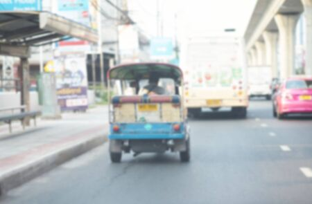 Blur photo of Tuk Tuk or three wheels motocycle on street view in Thailand travel concept Stock Photo