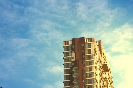 condo with sun rise light on side aspect on blue sky background in morning glory in asset concept 스톡 콘텐츠