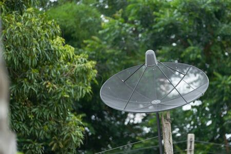 Satellite on roof point to sky for broadcast on nature background for backcountry communication Stock fotó