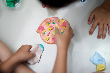 Kid make pizza colorful slime with container for kid activity concept Stock fotó