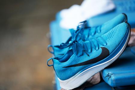 Bangkok ,Thailand ,Sept 22 ,2019-Nike sport shoe on hang tilt bar for dry after washing